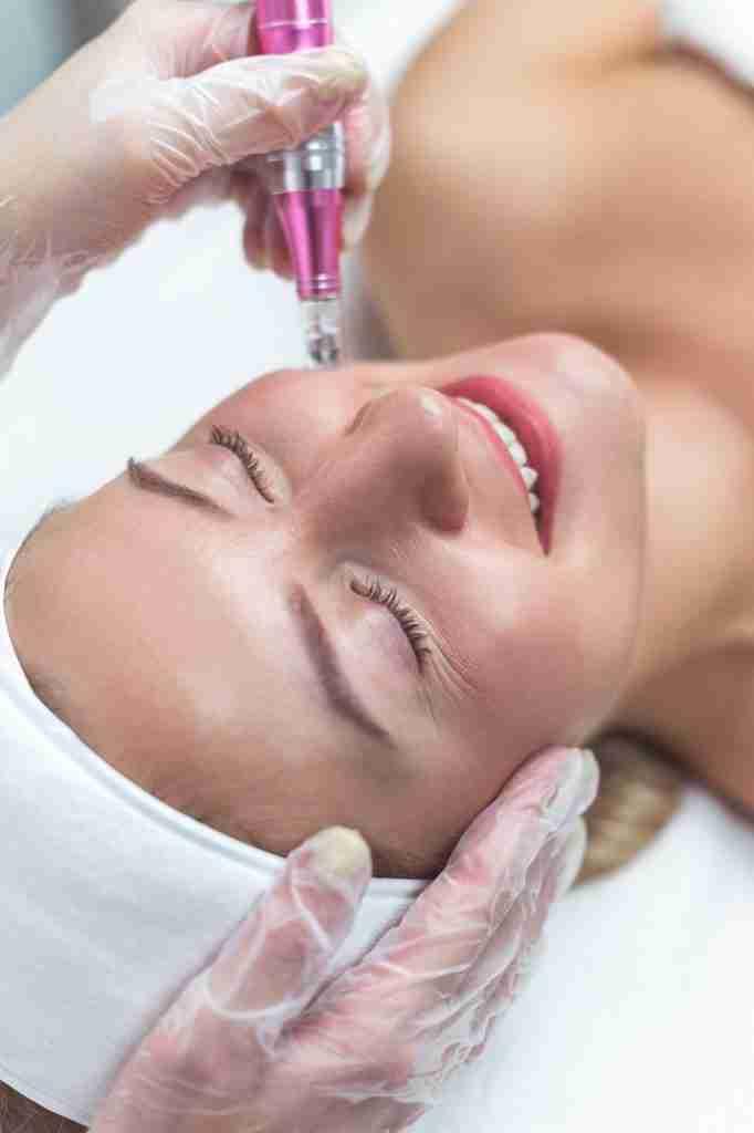 Woman having facial treatment in beauty salon, closeup. Oxy derma therapy